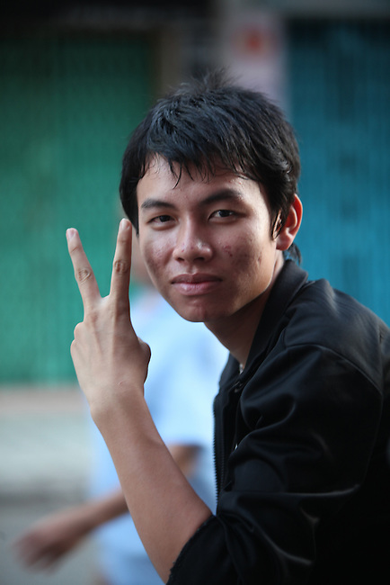 An early morning cafe patron poses for a photograph on Bui Vien Street in Ho Chi Minh City, Vietnam. Aug. 18, 2011.