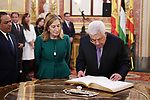 Palestinian President, Mahmoud Abbas, signs in the guests' book during his visit at the Lower House of the Spanish Parliament in Madrid, Spain, on November 21, 2017. Photo by Thaer Ganaim