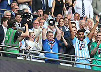 28th May 2018, Wembley Stadium, London, England;  EFL League 2 football, playoff final, Coventry City versus Exeter City; Coventry City manager Mark Robins lifts the EFL League 2 trophy from the gantry