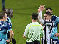 Matt Tootle of Notts Co applauds as Adebayo Akinfenwa of Wycombe Wanderers is sent off after receiving a 2nd yellow card during the Sky Bet League 2 match between Notts County and Wycombe Wanderers at Meadow Lane, Nottingham, England on 10 December 2016. Photo by Andy Rowland / PRiME Media Images.