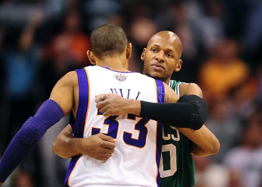 Jan. 28, 2011; Phoenix, AZ, USA; Boston Celtics guard Ray Allen (right) hugs Phoenix Suns forward Grant Hill at the US Airways Center. Mandatory Credit: Mark J. Rebilas-