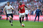 Paul Pogba of Manchester United is challenged by Jan Vertonghen of Tottenham Hotspur during the FA cup semi-final match at Wembley Stadium, London. Picture date 21st April, 2018. Picture credit should read: Robin Parker/Sportimage