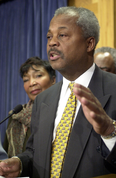 12cbc030801 -- Rep. Donald Payne, D-NJ, answers questions with the Congressional Black Caucus at a press conference opposing the President's tax plan.