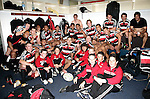 The Counties Manukau Steelers gather in the charging room with the ball boys after the Air New Zealand Cup rugby game between Counties Manukau & Hawkes Bay played at Mt Smart Stadium, 30th of September 2006. Hawkes Bay won 30 - 29.