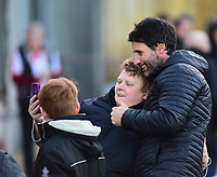 Lincoln City manager Danny Cowley poses for a selfie with Lincoln City fans<br /> <br /> Photographer Andrew Vaughan/CameraSport<br /> <br /> The EFL Sky Bet League Two - Lincoln City v Port Vale - Tuesday 1st January 2019 - Sincil Bank - Lincoln<br /> <br /> World Copyright © 2019 CameraSport. All rights reserved. 43 Linden Ave. Countesthorpe. Leicester. England. LE8 5PG - Tel: +44 (0) 116 277 4147 - admin@camerasport.com - www.camerasport.com