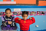 Education Preschool 4 year olds boy and girl posing in dressup outfits boy in dress and girl in super hero outfit
