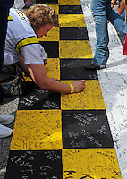 Nov. 22, 2009; Homestead, FL, USA; NASCAR Sprint Cup Series fans write messages on the start finish line prior to the Ford 400 at Homestead Miami Speedway. Mandatory Credit: Mark J. Rebilas-