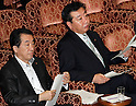 August 11, 2011, Tokyo, Japan - Japans Prime Minister Naoto Kan, left, and Finance Minister Yoshihiko Noda, one of the possible successors to the lame duck premier, attend an Upper House Budget Committee session at the Diet in Tokyo on Thursday, August 11, 2011. Now that opposition parties agreed to back legislation to finance this years budget, a condition set by Kan for resigning, Japans political paradigm has shifted to who would succeed Kan. The ruling Democratic Party of Japan is headed to hold a leadership vote by the end of August. Although he has not yet officially declared his candidacy, Noda is widely expected to face opponents in former Transport Minister Sumio Mabuchi, former Environment Minister Sakihito Ozawa and former Diet affairs chief Shinji Tarutoko, the latest name floated in the nations political center. (Photo by AFLO) [3609] -mis-