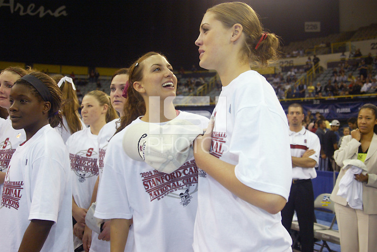 18 December 2004: Stanford Cardinal Jennifer Wilson and Michelle Mellard during Stanford's  30-23, 30-27, 30-21 victory over Minnesota in the 2004 NCAA Women's Volleyball National Championships in Long Beach, CA. Stanford won their sixth women's volleyball title in school history.<br />
