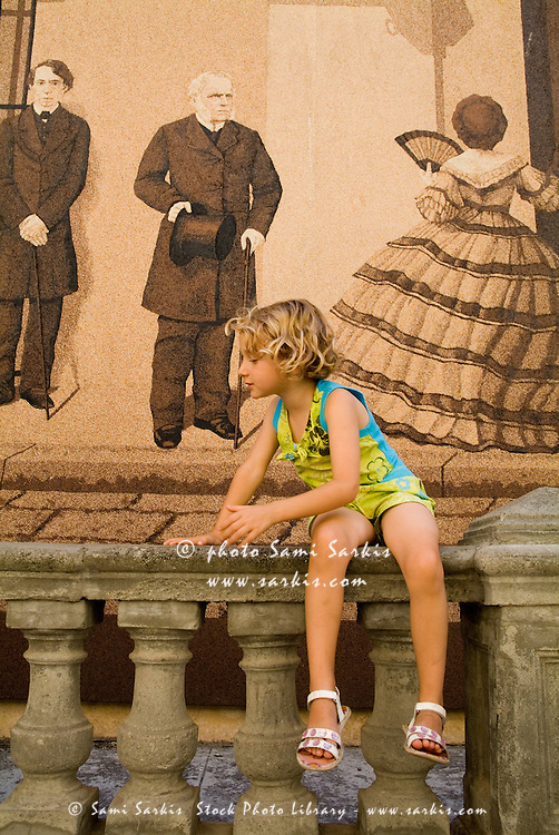 Little girl sitting on a balustrade, Havana, Cuba.