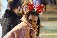 Pictured: A female reveler wearing antlers in Wind Street, Swansea, south Wales, UK. Friday 21 December 2018<br /> Re: Black Eye Friday, also known as Mad Friday or Black Friday which is the last Friday before Christmas Day.