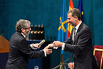 Prince Felipe of Spain gives to Antonio Munoz Molina the Prince of Asturias Award for Literature during the 2013 Prince of Asturias Awards ceremony at the Campoamor Theater in Oviedo, Spain. October 25, 2013..(ALTERPHOTOS/Victor Blanco)