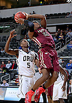 SIOUX FALLS, SD - MARCH 8: Davron Williams #15 of IUPUI shoots over defender Leo Svete #5 of Oral Roberts in the second half of their second round Summit League Championship Tournament game Sunday evening at the Denny Sanford Premier Center in Sioux Falls, SD. (Photo by Dave Eggen/Inertia)