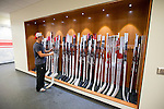 Wisconsin Badgers men's hockey player checks out his stick on move-in day at the LaBahn Arena Monday, October 1, 2012 in Madison, Wisc. (Photo by David Stluka)