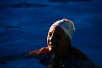 The Aqua Suns are a group of synchronized swimmers in Sun City, Arizona, an age-restricted city of retirees. Inge Natoli, 92, takes a break during a rehearsal for an upcoming holiday show at the Lakeview Recreation Center Pool December 2, 2013.