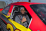 Scotty Washington of the Wake Forest Demon Deacons is ready for his ride in a NASCAR race car as part of the festivities for the 2017 Belk Bowl at the Charlotte Motor Speedway on December 26, 2017 in Concord, North Carolina.  (Brian Westerholt/Sports On Film)