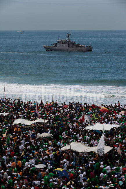 Thousands of faifthfull people gathered along Copacabana beach  to attend the mass of Pope Francis  in  Rio de Janeiro, Brazil