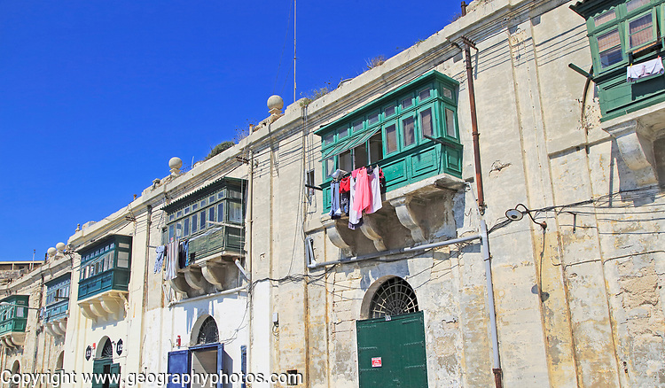 Old merchant house with balcony above warehouse area, Valletta, Malta