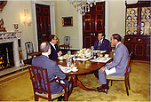 Washington, D.C. - May 31, 1974 -- United States President Richard M. Nixon sits down to a meal with his national security staff in the White House in Washington, D.C. on May 31, 1974. Pictured from left to right: Major General Brent Scowcroft, United States Air Force, Deputy Assistant to the President for National Security Affairs; United States Secretary of State Henry A. Kissinger, who also holds the title of Assistant to the President  for National Security Affairs; President Nixon; and General Alexander M. Haig, Jr., United States Army, Assistant to the President (Chief of Staff)..Credit: White House via CNP