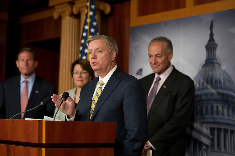 UNITED STATES - July 17: Bipartisan group of Senators Richard Bluenthal, D-CT., Amy Klobucher, D-MN., Lindsey Graham, R-SC., and Charles Schumer, D-NY., during a press conference on their support for an updated media shield bill that would codify the recently-announced Department of Justice guidelines into law. The group of senators will announce their support for Senator Charles E. Schumer's original media shield legislation, and also discuss possible additional provisions that would protect the First Amendment and assist law enforcement. (Photo By Douglas Graham/CQ Roll Call)