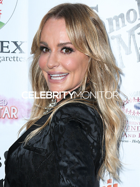 BEVERLY HILLS, CA, USA - SEPTEMBER 13: Taylor Armstrong arrives at the Brent Shapiro Foundation For Alcohol And Drug Awareness' Annual 'Summer Spectacular Under The Stars' 2014 held at a Private Residence on September 13, 2014 in Beverly Hills, California, United States. (Photo by Xavier Collin/Celebrity Monitor)