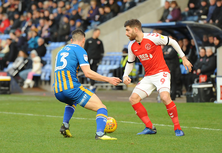 Fleetwood Town's Ched Evans under pressure from Shrewsbury Town's James Bolton<br /> <br /> Photographer Kevin Barnes/CameraSport<br /> <br /> The EFL Sky Bet League One - Shrewsbury Town v Fleetwood Town - Tuesday 1st January 2019 - New Meadow - Shrewsbury<br /> <br /> World Copyright © 2019 CameraSport. All rights reserved. 43 Linden Ave. Countesthorpe. Leicester. England. LE8 5PG - Tel: +44 (0) 116 277 4147 - admin@camerasport.com - www.camerasport.com