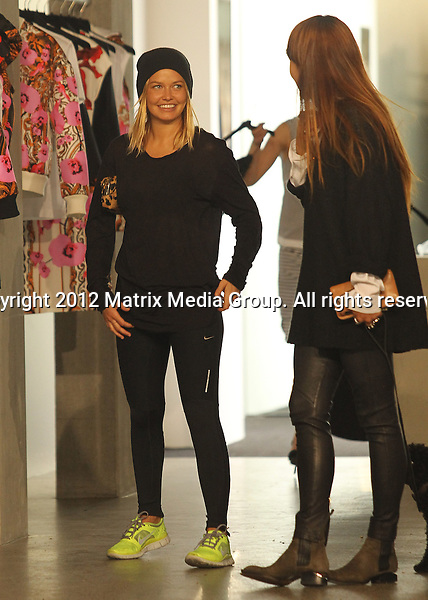 13.9.2012 DOUBLE BAY NSW AUSTRALIA..EXCLUSIVE PICTURES..Lara Bingle spotted shopping on Oxford Street with her new BFF and cute dog. Lara is pictured on a rare occasion purchasing a parking ticket before entering the Josh Goot boutique. ....*No internet without clearance*.MUST CALL PRIOR TO USE ..+61 2 9211-1088.Matrix Media Group.Note: All editorial images subject to the following: For editorial use only. Additional clearance required for commercial, wireless, internet or promotional use.Images may not be altered or modified. Matrix Media Group makes no representations or warranties regarding names, trademarks or logos appearing in the images.