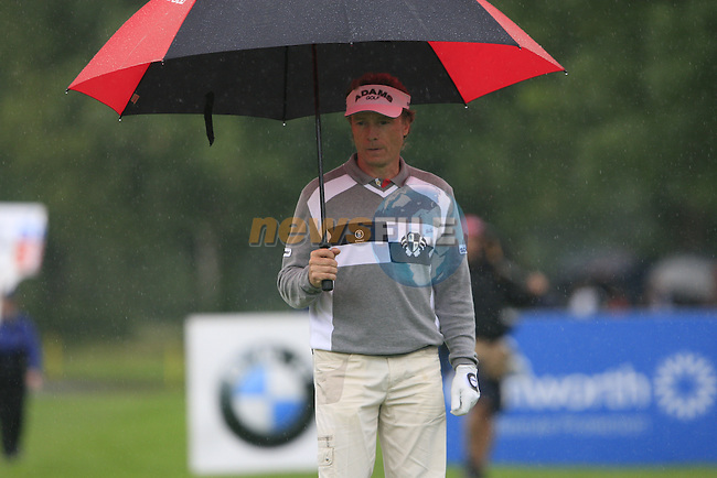 Bernhard Langer (GER) shelters from the rain on the 7th green during Day 1 of the BMW International Open at Golf Club Munchen Eichenried, Germany, 23rd June 2011 (Photo Eoin Clarke/www.golffile.ie)