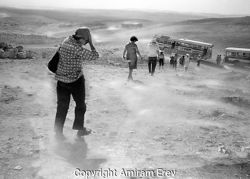 Excursion to the Negev. Buses await the wind-swept and dustry visitors, 1970s