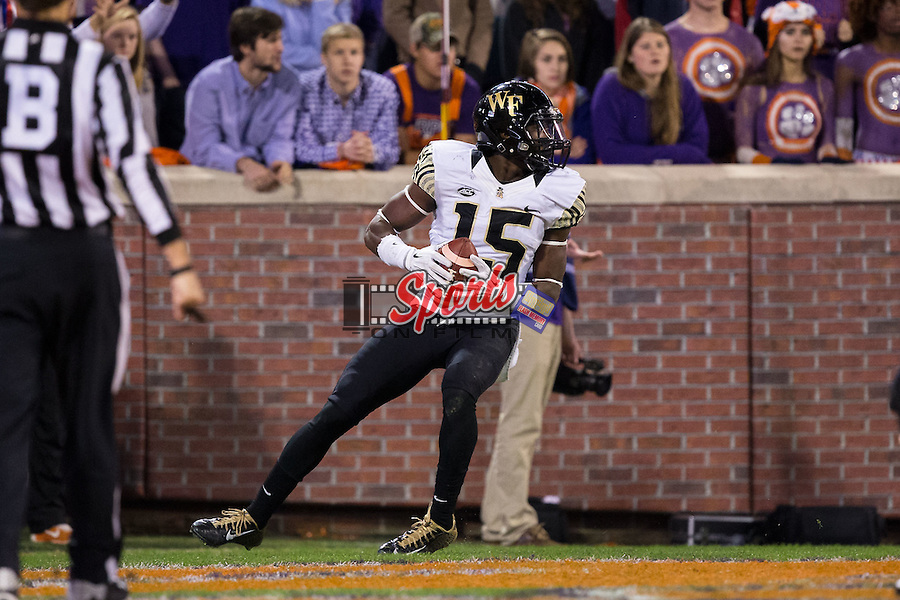 Cortez Lewis (15) of the Wake Forest Demon Deacons scores a touchdown during second half action against the Clemson Tigers at Memorial Stadium on November 21, 2015 in Clemson, South Carolina.  The Tigers defeated the Demon Deacons 33-13.   (Brian Westerholt/Sports On Film)