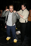 Merwin Foard (Past Gypsy Robe Winner-ASSASIANS) passing on his old LES MISERABLES Company Jacket to Alexander GEMIGNANI as an Opening Night Gift.<br />