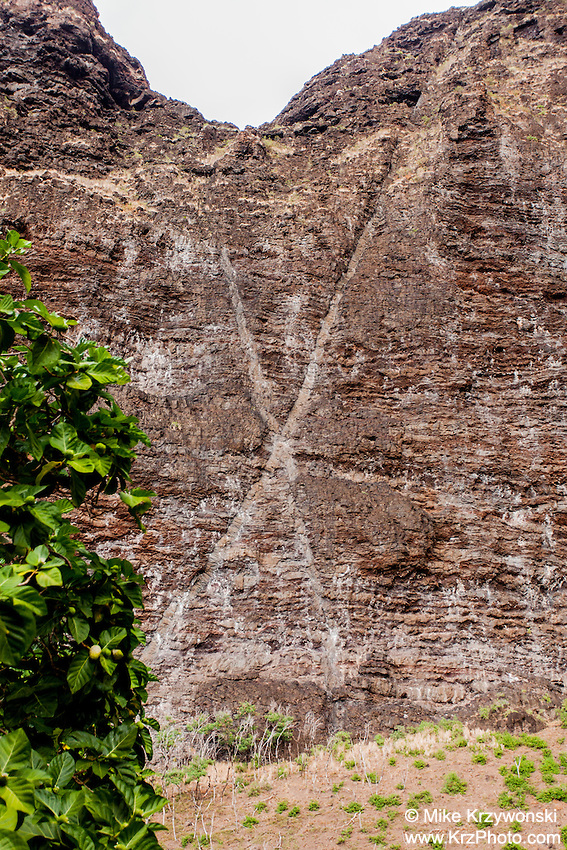 Hawaiian legend Pele's signature letter x carved onto side of cliff in Nualolo Kai village, Na Pali coast, Kauai