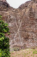 Hawaiian legend Pele's signature letter x carved onto side of cliff in Nualolo Kai village, Na Pali coast, Kauai