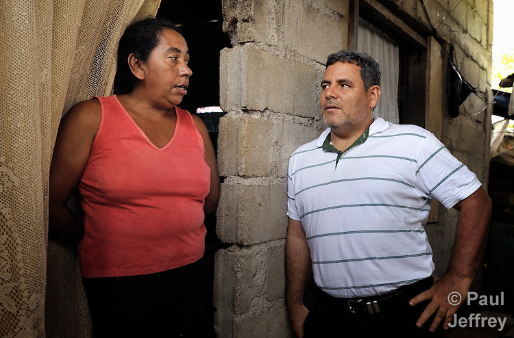 The Rev. Juan Guerrero, a native of Colombia, is a United Methodist missionary and superintendent of the church's mission in Honduras. Here he visits a church member in the town of Danli..