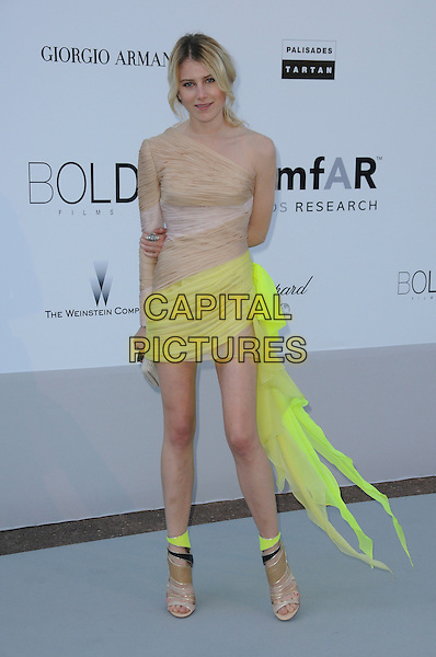 DREE HEMINGWAY.arrivals at amfAR's Cinema Against AIDS 2010 benefit gala at the Hotel du Cap, Antibes, Cannes, France during the Cannes Film Festival.20th May 2010.amfAR full length beige neon yellow dress ruched silk mini sandals one shoulder nude sleeve open toe shoes boots ankle .CAP/CAS.©Bob Cass/Capital Pictures.