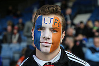 A Luton Town fan with their face painted in club colours ahead of the Sky Bet League 2 match between Luton Town and Crawley Town at Kenilworth Road, Luton, England on 12 March 2016. Photo by David Horn/PRiME Media Images.