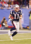New England Patriots wide receiver Julian Edelman (11) returns a kick during the NFL Super Bowl XLVI football game against the New York Giants on Sunday, Feb. 5, 2012, in Indianapolis. The Giants won 21-17 (AP Photo/David Stluka)...