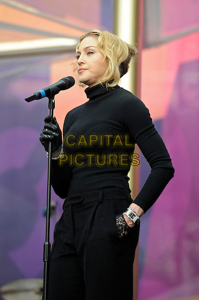 Madonna<br /> Presenting at the 'Chime For Change' concert, Twickenham Stadium,  London, England. 1st June 2013 <br /> music live on stage gig half length black gloves polo neck top speaking microphone lace side <br /> CAP/MAR<br /> &copy; Martin Harris/Capital Pictures