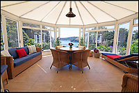 BNPS.co.uk (01202 558833)<br /> Pic: LillicrapChilcott/BNPS<br /> <br /> Room with a view...<br /> <br /> With its crystal clear azure waters and sandy beach, people could mistake this coastal home for somewhere in the Mediterranean but the aptly named Blue Waters - on the market for &pound;1.85m - is actually in Cornwall.<br /> <br /> The elegant 1920s house is in a prized position on the sought-after 'Cornish Riviera' - so called because of the calm clear waters on the south coast of Cornwall near St Austell.<br /> <br /> Blue Waters has the best of both worlds as it is in an incredibly private setting directly above the pretty Porthpean Beach, with easy access through a garden gate to the coastal path.<br /> <br /> The property, on the market with Lillicrap Chilcott, has outstanding views across St Austell Bay and along Black Head, as well as out across the English Channel.