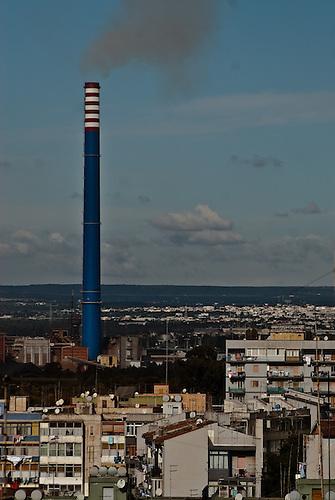 Taranto Italy 2010<br /> The E312 chimney, the highest of ILVA steelworks, located near the Tamburi quarter in Taranto.