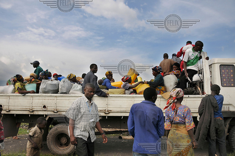 Displaced people prepare to leave the Kibati IDP (Internally Displaced Persons) camp and return to their homes.