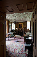 The drawing room features an ornate Jacobean plasterwork ceiling