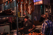 Shop vendors wait for customers at their kebab stall in Nizamuddin, New Delhi, India.
