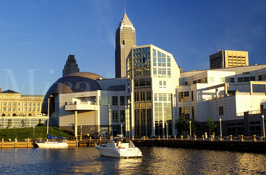 Cleveland, OH, Ohio, Skyline of downtown Cleveland and the Great Lakes Science Center along the waterfront of North Coast Harbor.