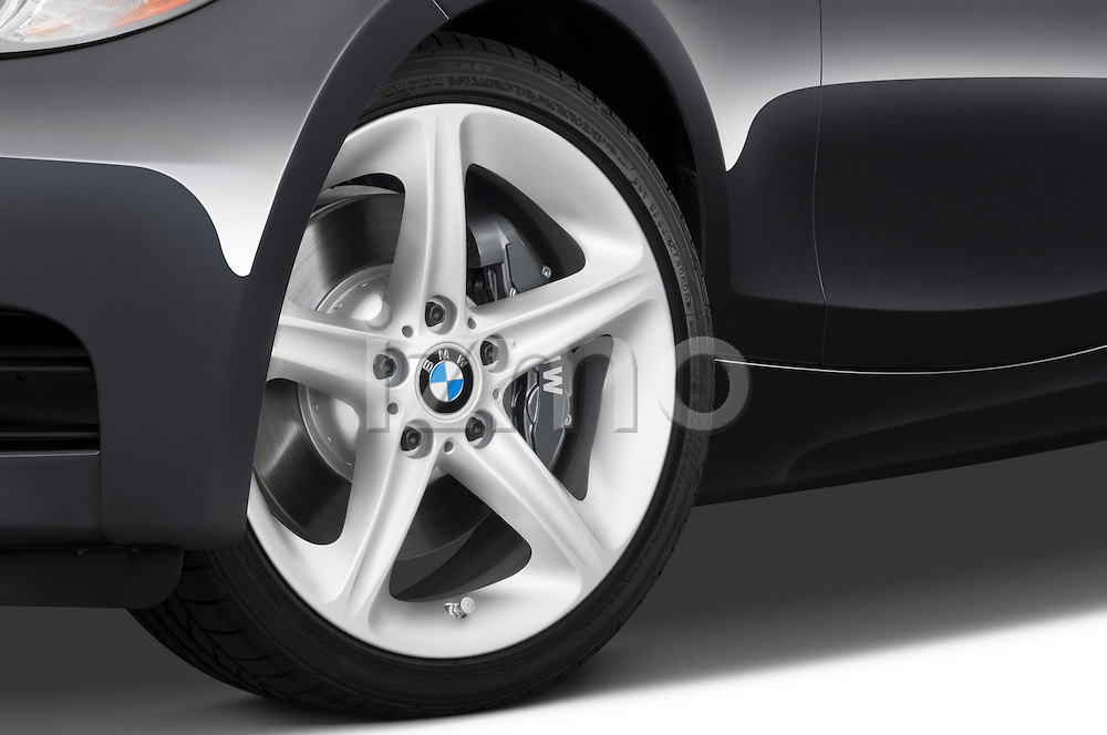 Tire and wheel close up detail view of a 2007 - 2011 BMW 1-Series 135i convertible.