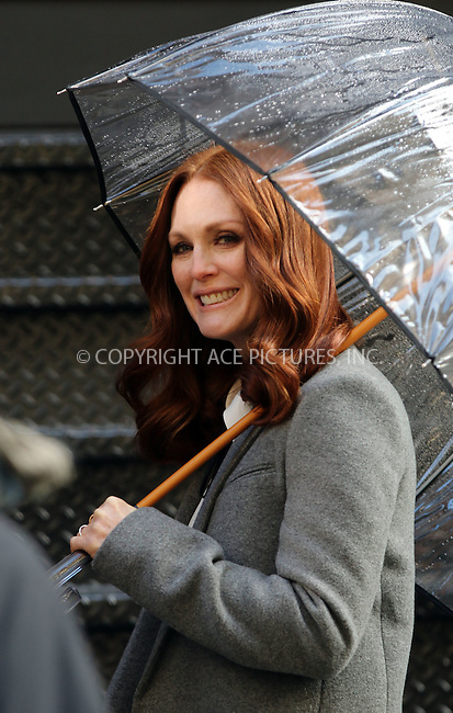 WWW.ACEPIXS.COM<br /> <br /> January 22 2015, New York City<br /> <br /> Actress Julianne Moore took part in a photoshoot for L'Or&eacute;al in downtown Manhattan on January 22 2015 in New York City<br /> <br /> By Line: Zelig Shaul/ACE Pictures<br /> <br /> <br /> ACE Pictures, Inc.<br /> tel: 646 769 0430<br /> Email: info@acepixs.com<br /> www.acepixs.com