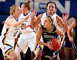 BROOKINGS, SD - NOVEMBER 3: Madison Guebert #11 and Kerri Young #10 from South Dakota State poly pressure to Rylie Osthus #10 from Dakota Wesleyan in the first half of their exhibition game Thursday night at Frost Arena. (Photo by Dave Eggen/Inertia)