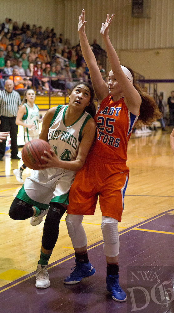 Greenland's Kim Crown is fouled by Two Rivers Grace Coates as she goes in for a layup during Saturday's 3A Regional final in Lavaca.