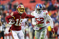 Landover, MD - December 9, 2018: Washington Redskins wide receiver Josh Doctson (18) stiff arms New York Giants outside linebacker Alec Ogletree (52) during the  game between New York Giants and Washington Redskins at FedEx Field in Landover, MD.   (Photo by Elliott Brown/Media Images International)