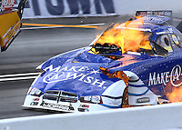 May 31, 2014; Englishtown, NJ, USA; NHRA funny car driver Tommy Johnson Jr explodes an engine on fire during qualifying for the Summernationals at Raceway Park. Johnson was unhurt. Mandatory Credit: Mark J. Rebilas-